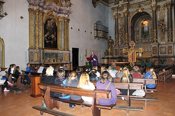 Father Andrew Strobl, chaplain at St. Thomas Aquinas High School in Overland Park, celebrates Mass for the group of Aquinas students that made a pilgrimage to Italy. The trip was planned long before Pope Benedict XVI announced his resignation. Photo courtesy of Father Andrew Strobl.