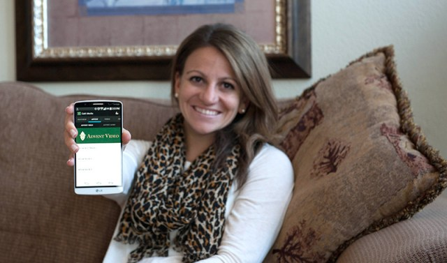 Betsy Helow, pastoral associate with the archdiocesan office of evangelization, demonstrates the new Catholic Media ArchKCK app which her office helped create. The app draws its content from the archdiocesan Digital Media Center and is free for immediate download on all platforms.