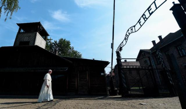 "Pope Francis enters the main gate of the Auschwitz Nazi death camp in Oswiecim, Poland, July 29. Following a joint visit to the camp in Poland in early November, Israeli religious leaders urged world leaders to act with ""unwavering resoluteness"" against the anti-Semitism and hatred toward others becoming more prevalent in today's society. (CNS photo/Alessia Giuliani, pool)) See ISRAEL-RELIGIOUS-LEADERS-AUSCHWITZ Nov. 10, 2016."