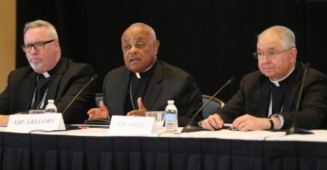 Atlanta Archbishop Wilton D. Gregory, center, speaks during a news conference Nov. 14 during the annual fall general assembly of the U.S. Conference of Catholic Bishops in Baltimore. At left is Bishop Christopher J. Coyne of Burlington, Vt., and at right is Archbishop Jose H. Gomez of Los Angeles. (CNS photo/Bob Roller) See BISHOPS- Nov. 14, 2016.