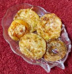fried green tomato slices in serving dish