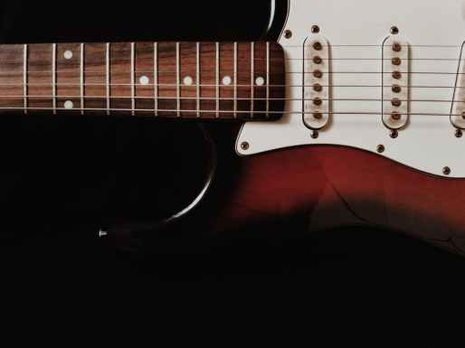 close up photo of white electric guitar