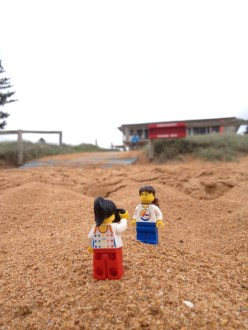 Taking pictures in front of the Summer Bay Surf Club!