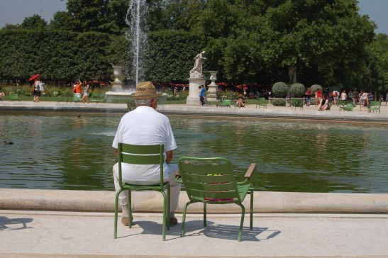 Old man in le Jardin des Tuileries. Artistic shot of day.