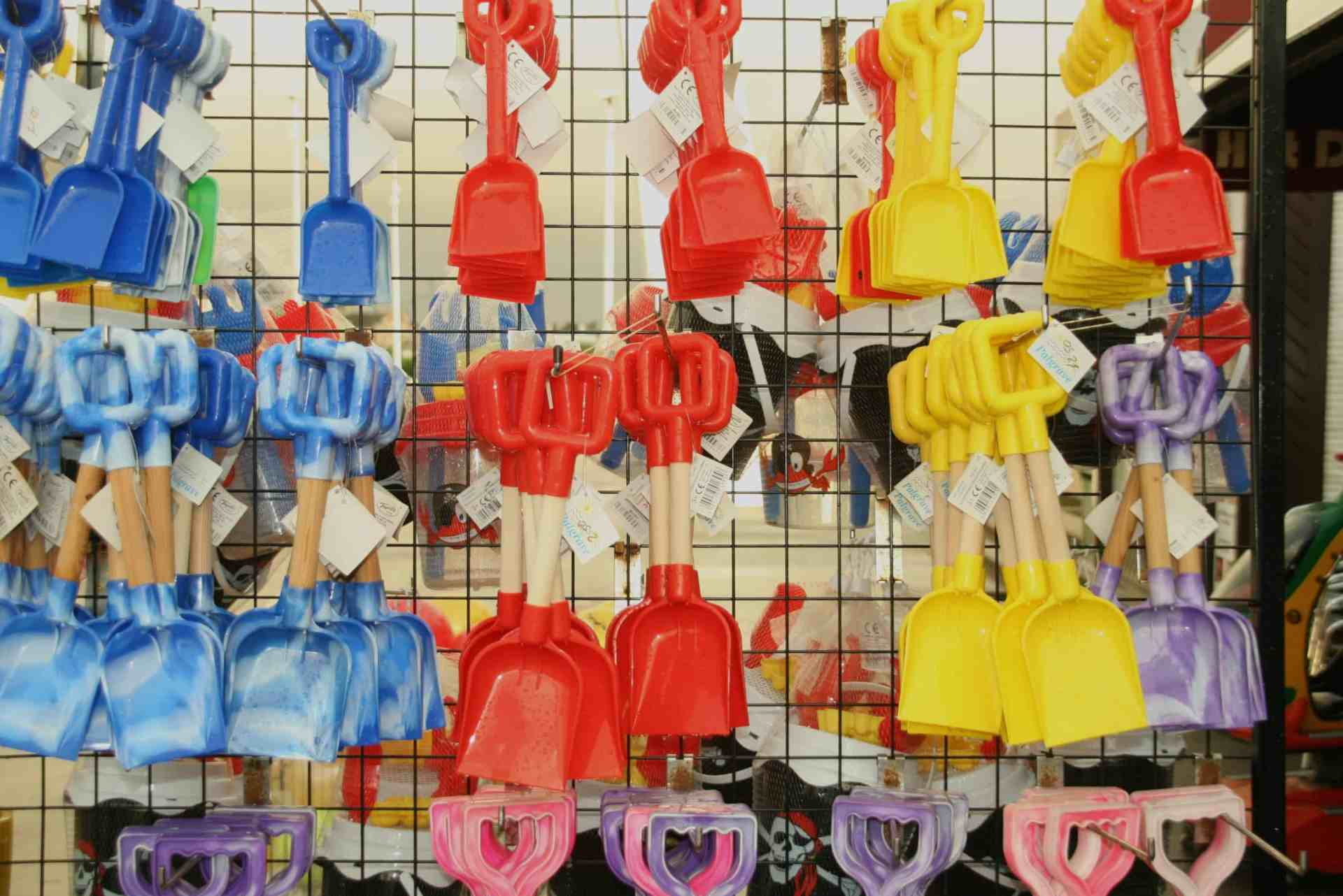 Colourful spades in a seaside shop. Southend, Essex