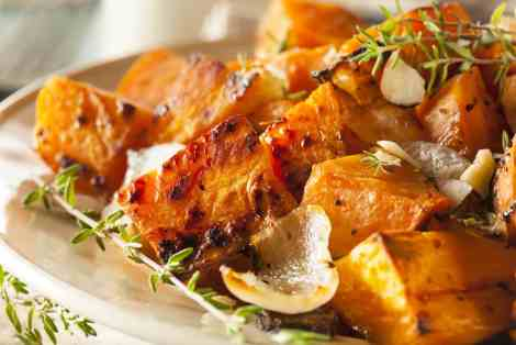 Veggie homemade cooked sweet potato with onions and herbs (c) Brent Hofacker.