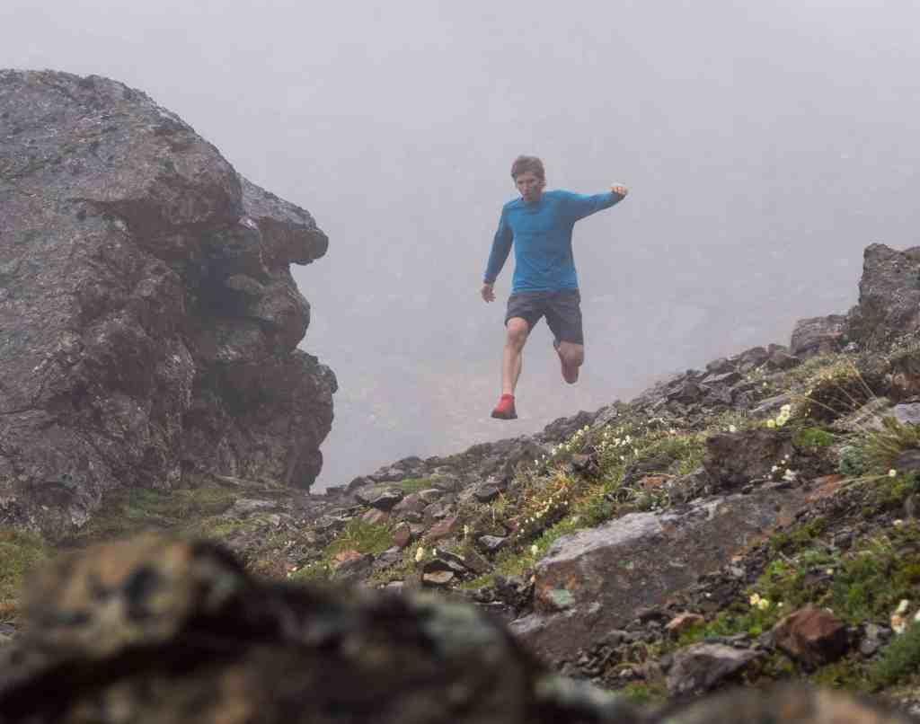 Mt Marathon Champion and record holder David Norris running in the Chugach mountains in the fog above Anchorage Alaska