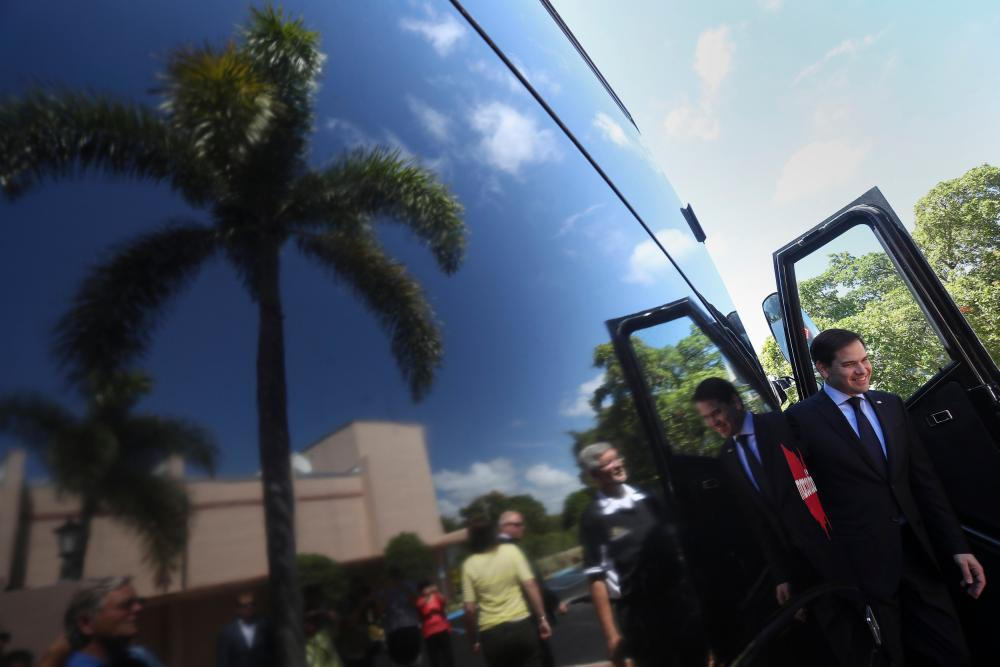 Marco Rubio steps off his campaign bus to attend an event in West Palm Beach.