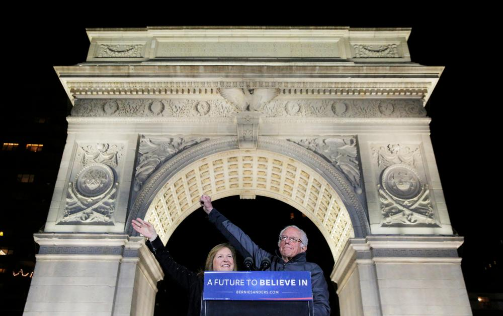 Bernie Sanders and wife Jane greet his supporters.