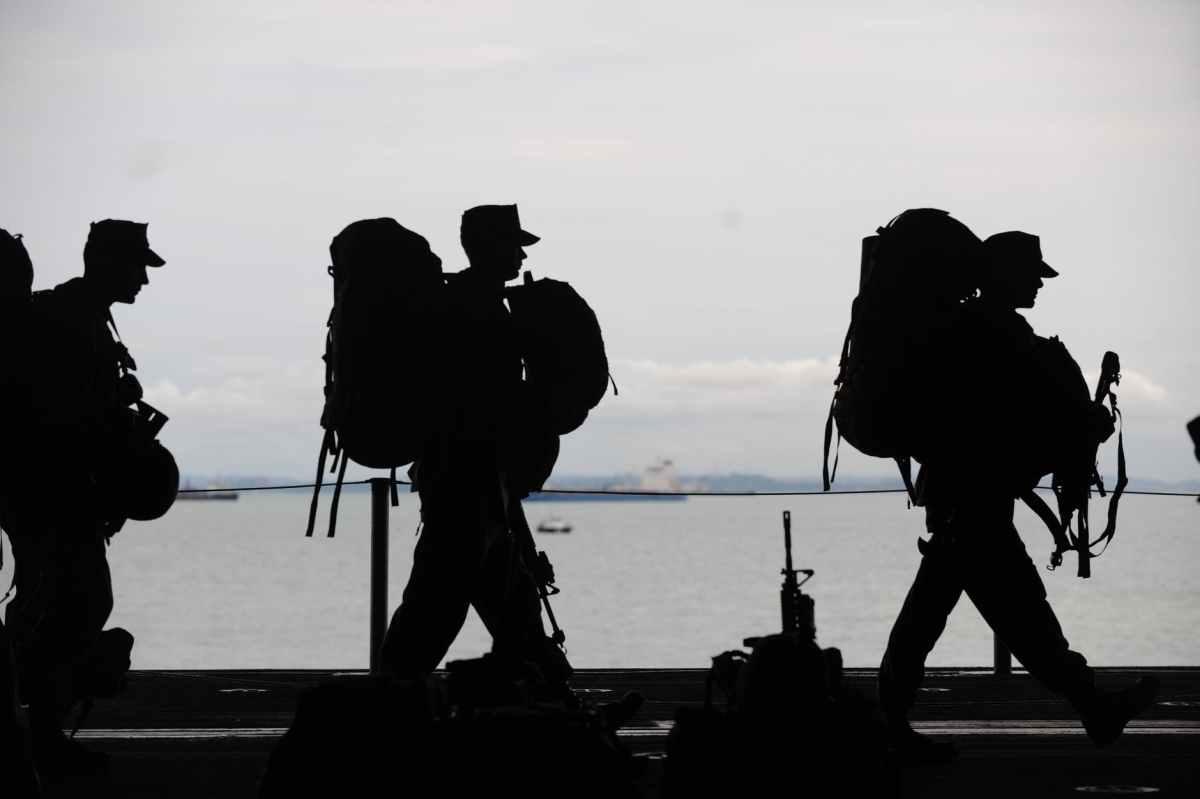 silhouette of soldiers walking