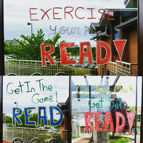 Summer Read & Learn logs. Window display using window paint.