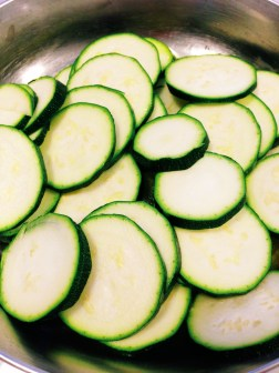 Add our zucchini to the pan...