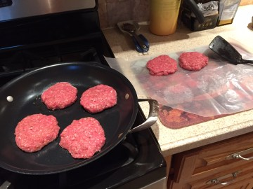 Frying up the hand pressed burger patties