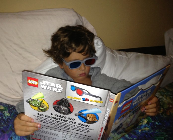 Cool kid reading with glasses