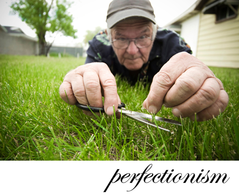 man cutting grass with siccors
