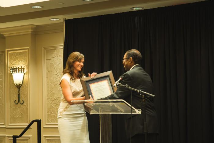 JM receiving award