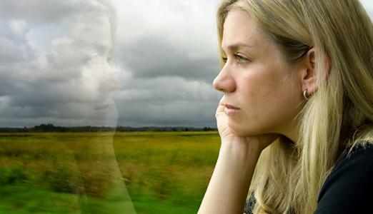 lady sitting in open field