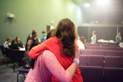 Two women embracing at a single mom support group