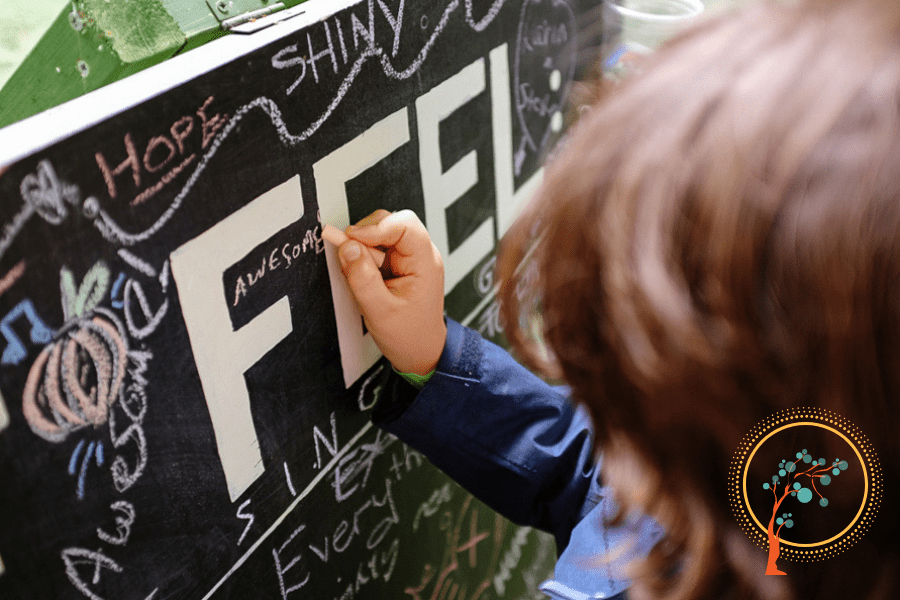 "boy drawing on chalkboard ""feel awesome"""