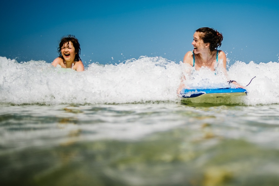 mother and child body boarding together