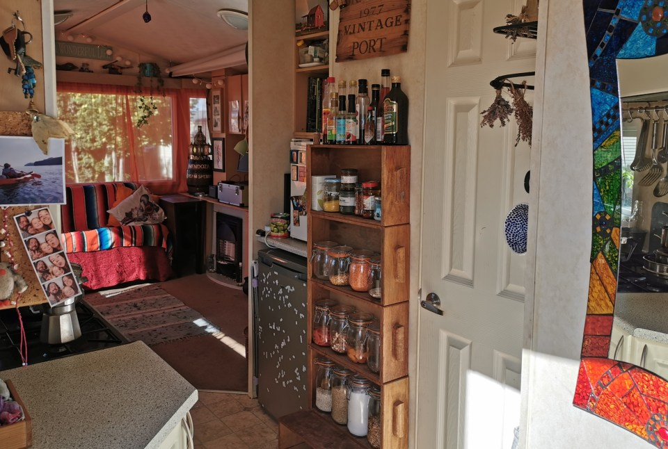 image of the interior of a tiny home, including kitchen pantry made of old desk drawers