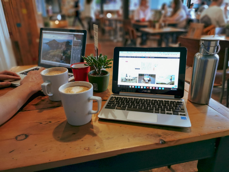 image of 2 laptops in a coffeeshop