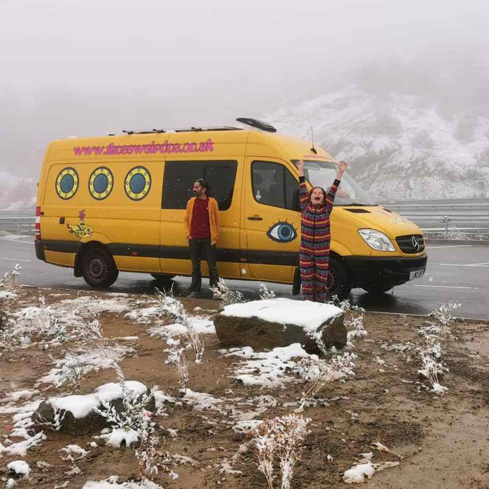 image of a self-converted campervan, decorated to look like a yellow submarine