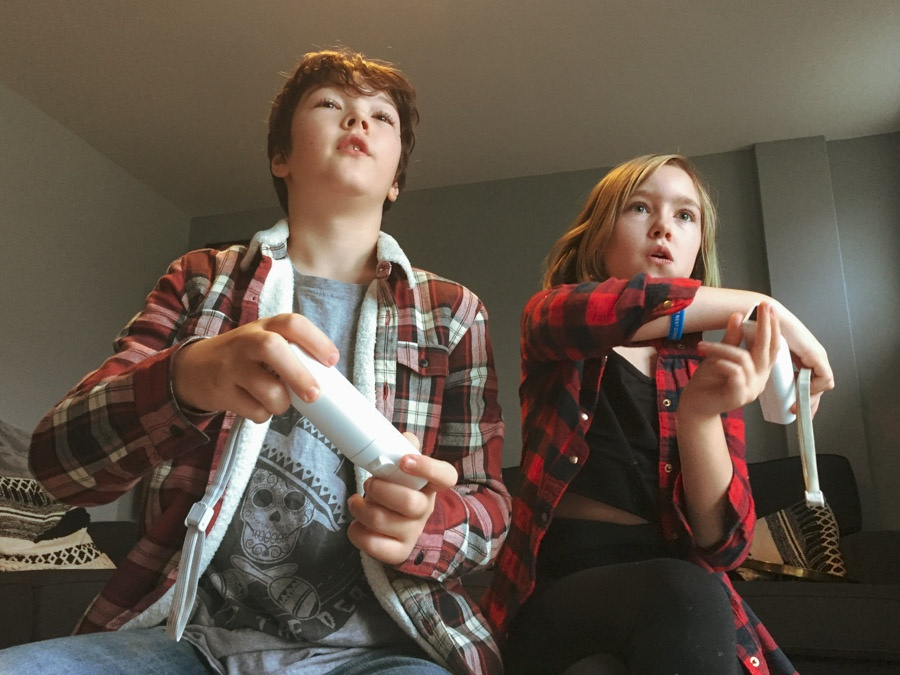 Image of 2 children playing on a games console