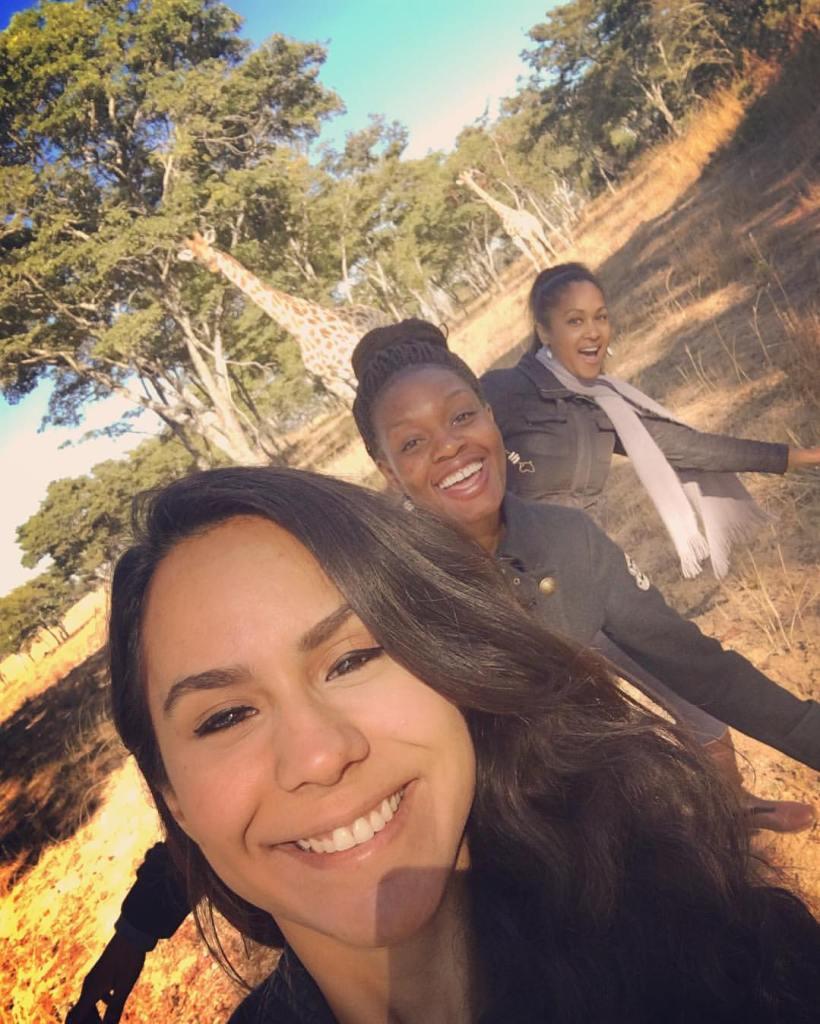 Africa - Zimbabwe - Imire Game Park - Girls and giraffes