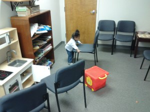 K seems to have taken the whole moving idea to heart.  She is even into rearranging doctor's offices while she waits.