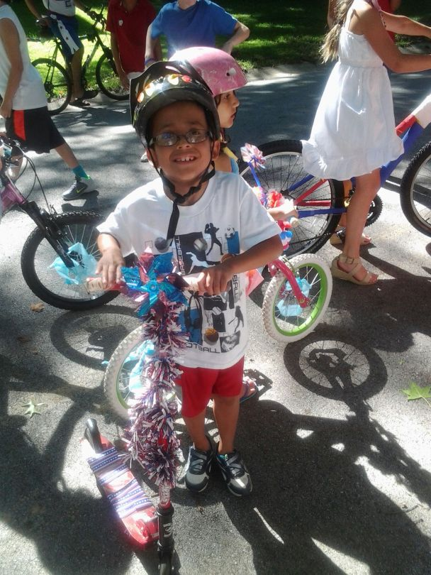 O with his decorated scooter for the July 4th traditional parade.