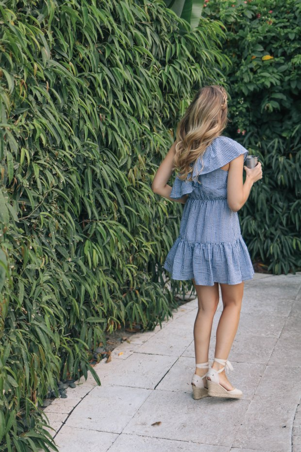 Fashion blogger, Leigha Gardner, of The Lilac Press wearing a blue gingham one-shoulder dress in Miami
