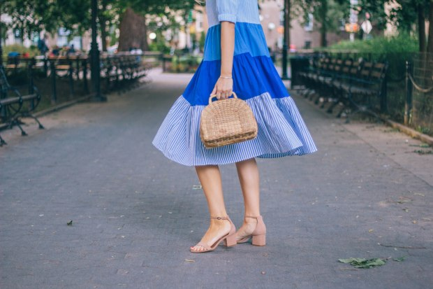 Style blogger, Leigha Gardner, of The Lilac Press sharing a favorite blue color blocked striped dress twirling around Washington Square Park, NYC.