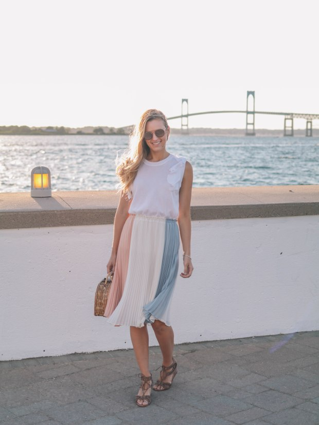 Style blogger, Leigha Gardner, of The Lilac Press wearing a cream, rose and gray-blue colorblocked skirt for dinner in Newport.