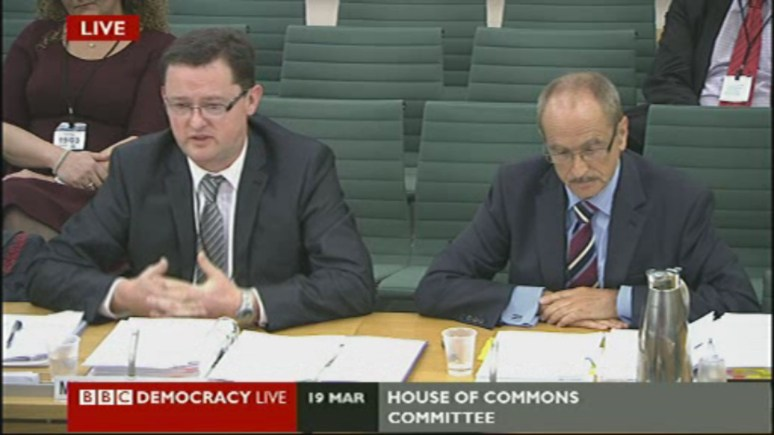 Former ULHT boss Gary Walker (left) and former chair David Bowles talk to the Health Select Committee as part of an inquiry into high death rates.