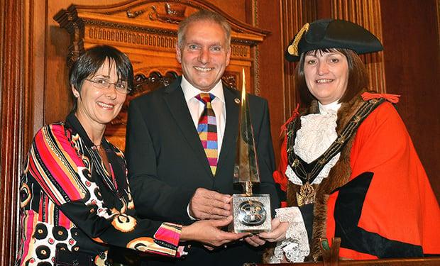 Lincoln Mayor Councillor Karen Lee presents the Lincoln Civic Award to Running Imp International's directors Caroline Birkin and Chris Illsley.