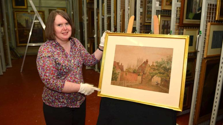 Dawn Heywood, Collections Access Officer at The Collection, shows off the Peter DeWint painting. Photo: Steve Smailes for The Lincolnite