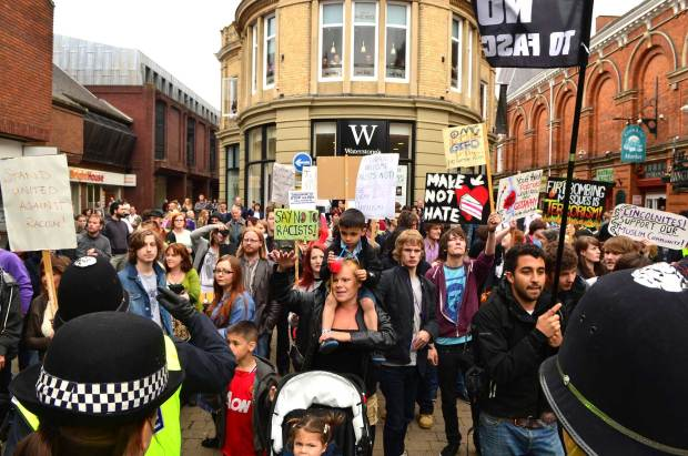 Anti-racism demonstrators chanting at the anti-mosque protesters on June 8, 2013. Photo: Steve Smailes for The Lincolnite