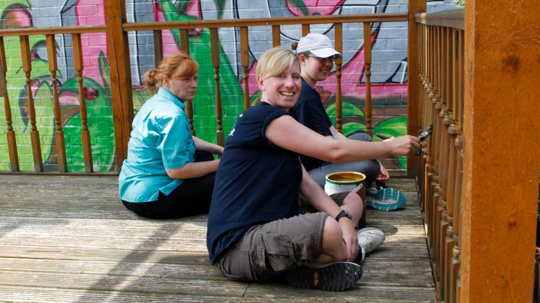 YMCA resident Lorna (back left), and Co-op volunteers Alison (back right) and Rachel (front right).
