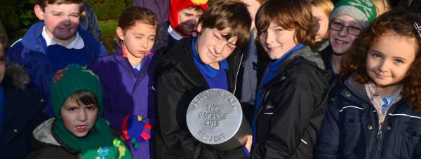 Schoolchildren buried a time capsule in Boultham Park in Lincoln. Photo: Steve Smailes for The Lincolnite