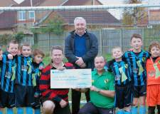 Karl McCartney MP presenting the cheque to Birchwood Colts Chairman,  Andy Brown, with city councillor for Birchwood Eddie Strengiel.
