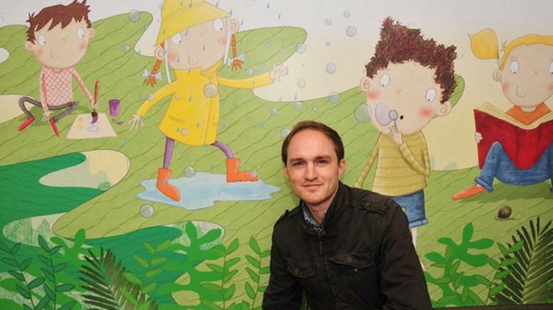 Mark Chambers with his illustrations in ZSL London Zoo.