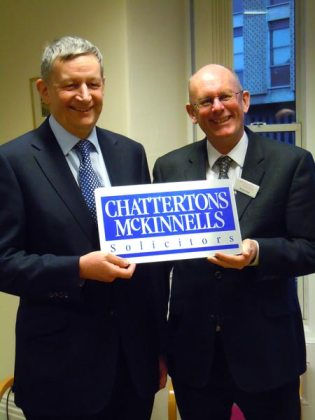 Senior Partner of Chattertons, Peter Lawson and Senior Partner of McKinnells, Richard Hare, celebrate the solicitors' merger.