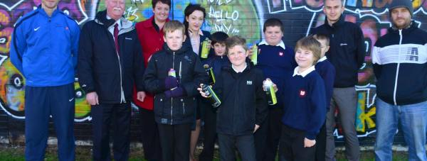 (L-R) Jake Marshall of Positive Futures, Neighbourhood Manager Noel Tobin, Emily McClean  and Shannon Firby of Lincoln Castle Academy, Mclaren Staples, Brandon Atkins, Ali Thompson-Clay, Martyn Turner, Ethan Keely, Jacob Daniels and artist James Mayle with the St Giles graffiti wall. Photo: Steve Smailes for The Lincolnite
