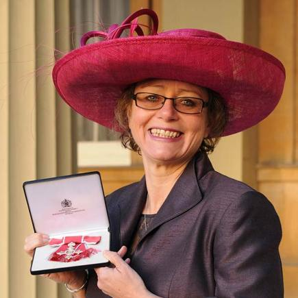 Nikki and her MBE. Photo: PA