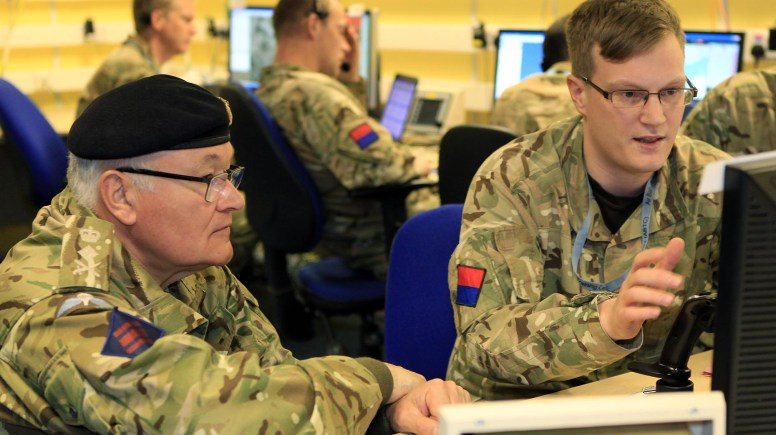 Chief of the General Staff, General Sir Peter Wall (left) speaks to Bombardier Graham Hill (right) of 47 Royal Artillery about Exercise Mountain Dragon. Photo: RAF Waddington