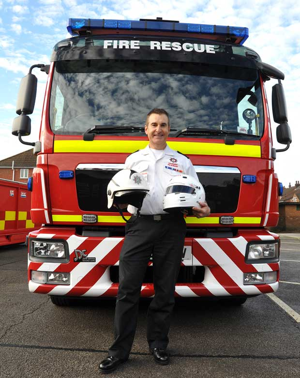 Mike is looking forward to swapping his uniform for his racing helmet. Photo: Yellow Story