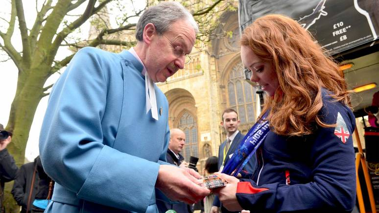 John Campbell, Dean's Verger at Lincoln Cathedral admiring Jade's medals. Photo: Steve Smailes for The Lincolnite
