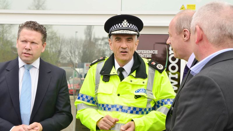 Lincolnshire Police Chief Constable Neil Rhodes and Lincoln MP Karl McCartney speaking with minster of state for Police and Criminal Justice Damian Green on Lincoln visit in 2014. Photo: Steve Smailes for The Lincolnite