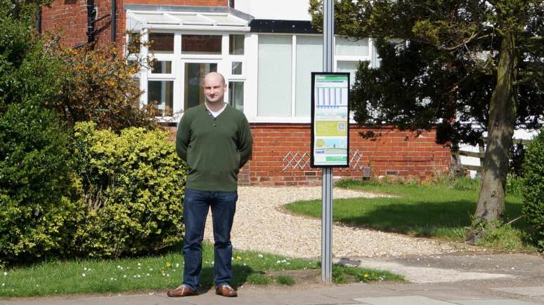 Councillor Marc Jones next to where the bus stop once stood.